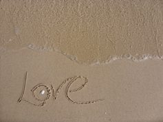 Love spelled out on the sand